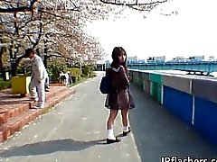 Asian schoolgirl enjoys outdoors