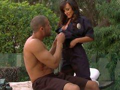 Buxom woman Lisa Ann in police uniform does oral job