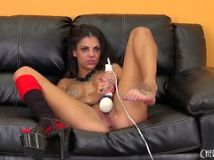 Hot tattooed brunette Bonnie toys herself and sits on a pecker