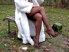 Seamed black stockings and fur in the park