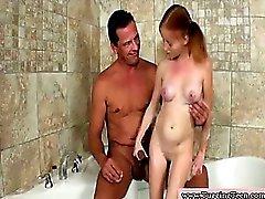 Petite redhead wanks an old cock in bath