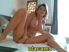 Busty blonde milf ride a dildo on cam