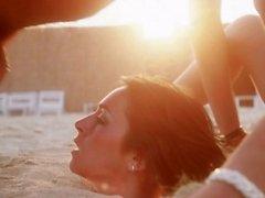 Cathy Menard buried in sand