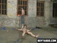 Tied up hunk squirming as he gets covered in hot wax