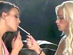Smoking lesbians kissing on black sofa 120's