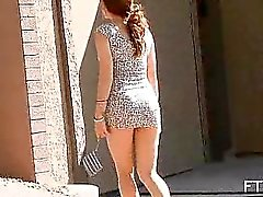 Relaxed lady in sexy dress toying her pussy outdoor