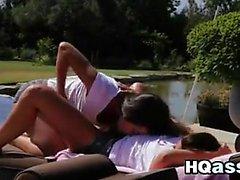 Lesbians Having Fun Outside By A Pool