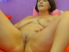 Brunette with giant tits posing to the webcam