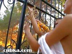 Charming lezzs fingering in a garden