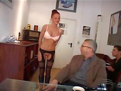 Redhead Dona Lucia is giving this old guy head and banging him