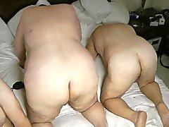 Sklavin machen Vorbereitungsarbeit am 2 verheiratet weichling Reisigbündeln