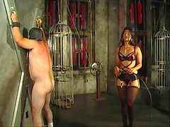 Hot looking mistress Delilah spanking her slave for fun
