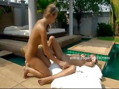 Lesbian blonde cuties outdoor near a pool kissing with passion before licking each other