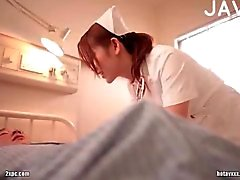 Busty Jap nurse teasing guy
