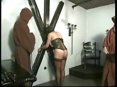 Hot slave totally naked only wearing a masked tied to a wall is hit a whip on her beautiful ass