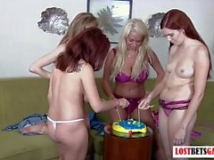 4 babes play a game of Fish, loser strips and faces punishment