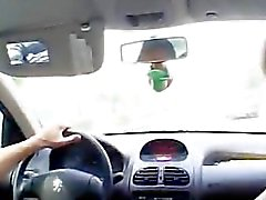Arabic chick learns driving a car