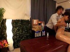 Tan naked Japanese milf receives sensual oil massage