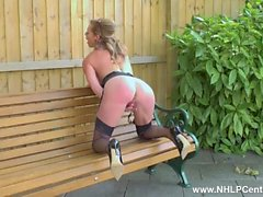 Kinky Milf Holly Kiss masturbates on public bench in nylons garters heels