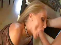 Hot busty MILF Julia Ann slurps up his cock and then gets banged