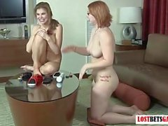 Two babes play strip table air hockey