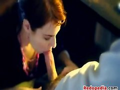 Red Haired Secretary Sucking On A Cock