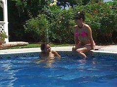 Two Asian girls having fun at the pool
