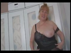 Busty chubby granny rubs her hairy pussy and then shows it off
