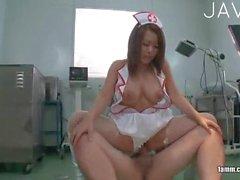 Busty Jap nurse doggystyled