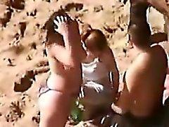 Slut Gives A Blowjob At The Beach
