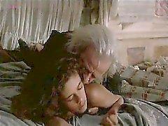 De Ana Knecht se vista miente en cama mientras que un hombre entra en un comienza