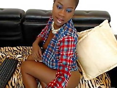 Ebony Jessy tries to hide her big tits and pussy udner shirt