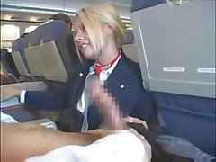 Horny blonde stewardess servicing aroused male passengers on board
