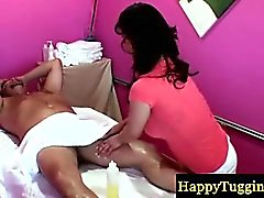 Asian masseur tugging her clients cock