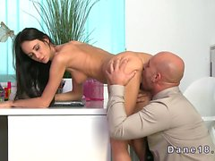 Slim brunette babe fucking huge cock in an office