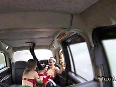 Lesbian Santa and elf toying in fake taxi
