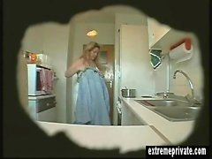 Spy footage of my sexy mom in the kitchen