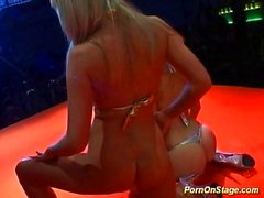 Lesbians licking pussy on stage