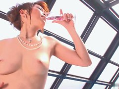 Busty Japanese babe masturbates by the pool