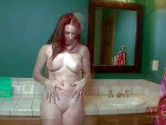 Young redhead Melody Jordan poses naked in the bathroom
