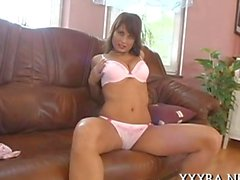 Lady in lingerie toys her landing strip pussy