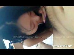 Lovely Asian girl sucking her boyfriends cock