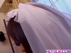 Nami Asakura in wedding dress rubs it with gloves