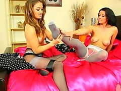 Two brunette lezzies fingering in nylons