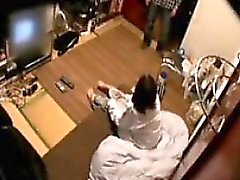 Cute Japanese wife is filmed on hidden cam undressing her h