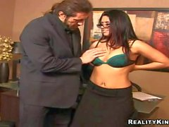 busty secretary brunette gives head to her muscled boss boss