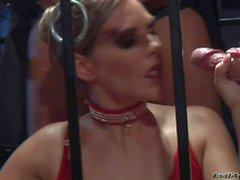 Brianna gets her hands busy while in cage