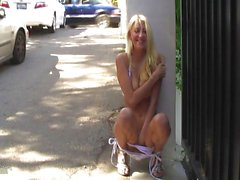 Sexy blonde naked on the streets