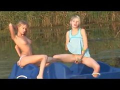 Nude Beach - Two Blond Teens Playing on the Water