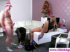 Femdom gives a guy a foot and a hand job
